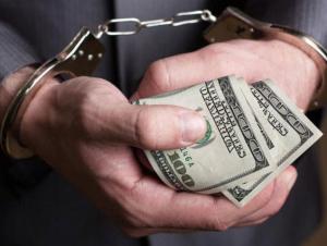 Коллеж директори ўринбосари 1000 доллар пора билан ушланди